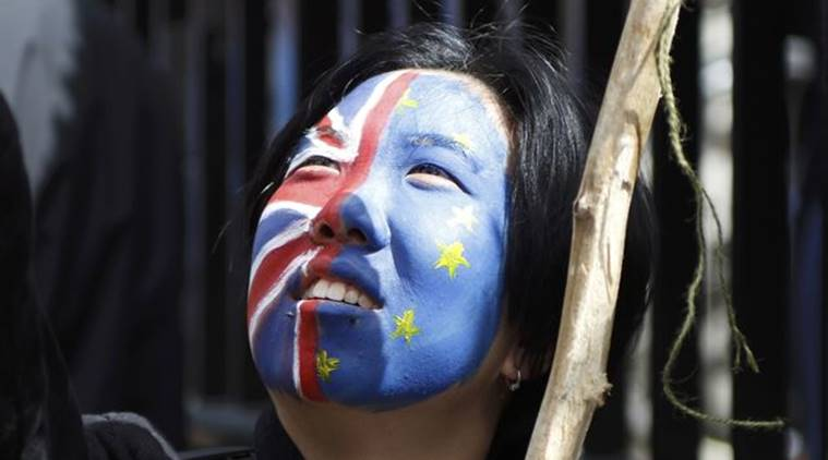 A woman looks upwards during a demonstration in BREXIT