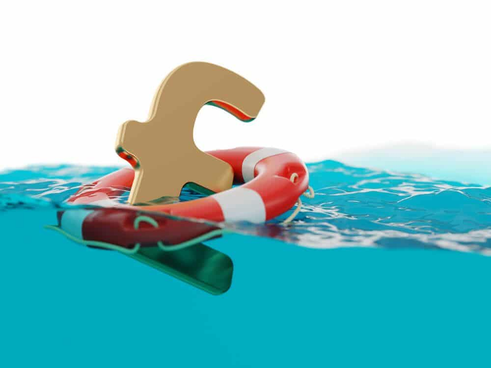 GBP currency floating in the water with safety round