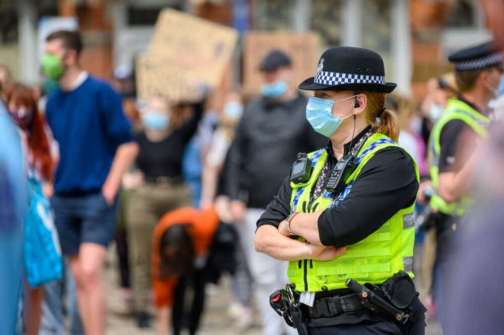 A female Police Officer wears a PPE Face Mask