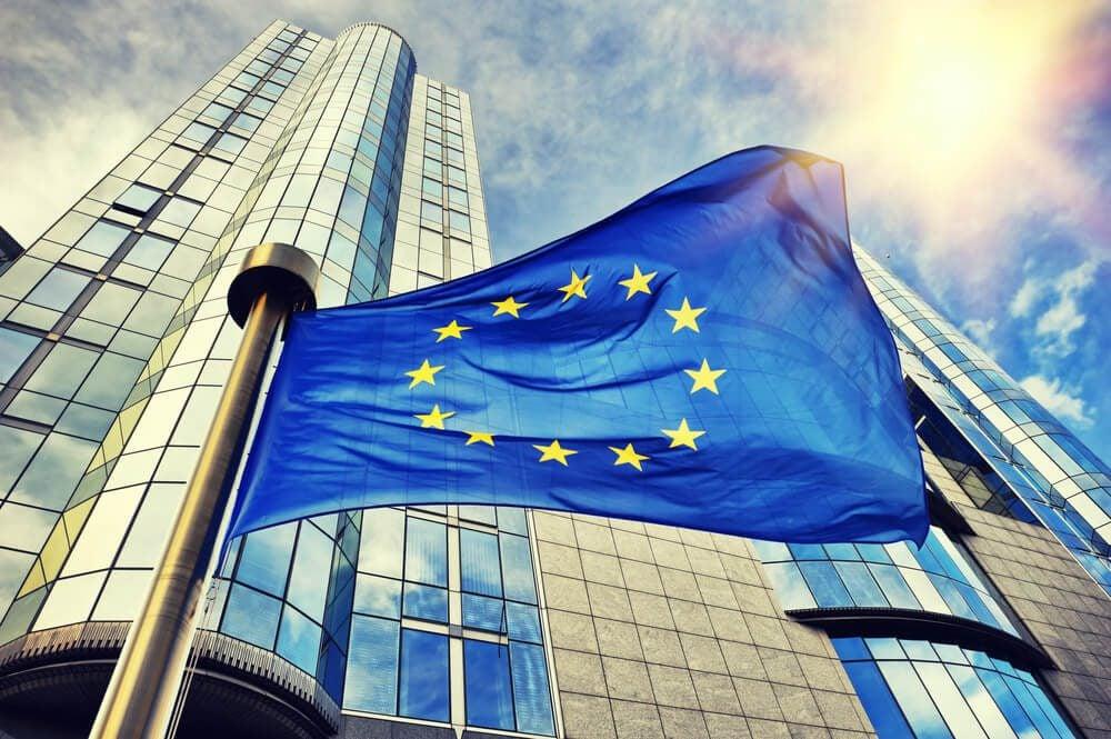 EU flag waving in front of European Parliament building. Brussels Belgium 1