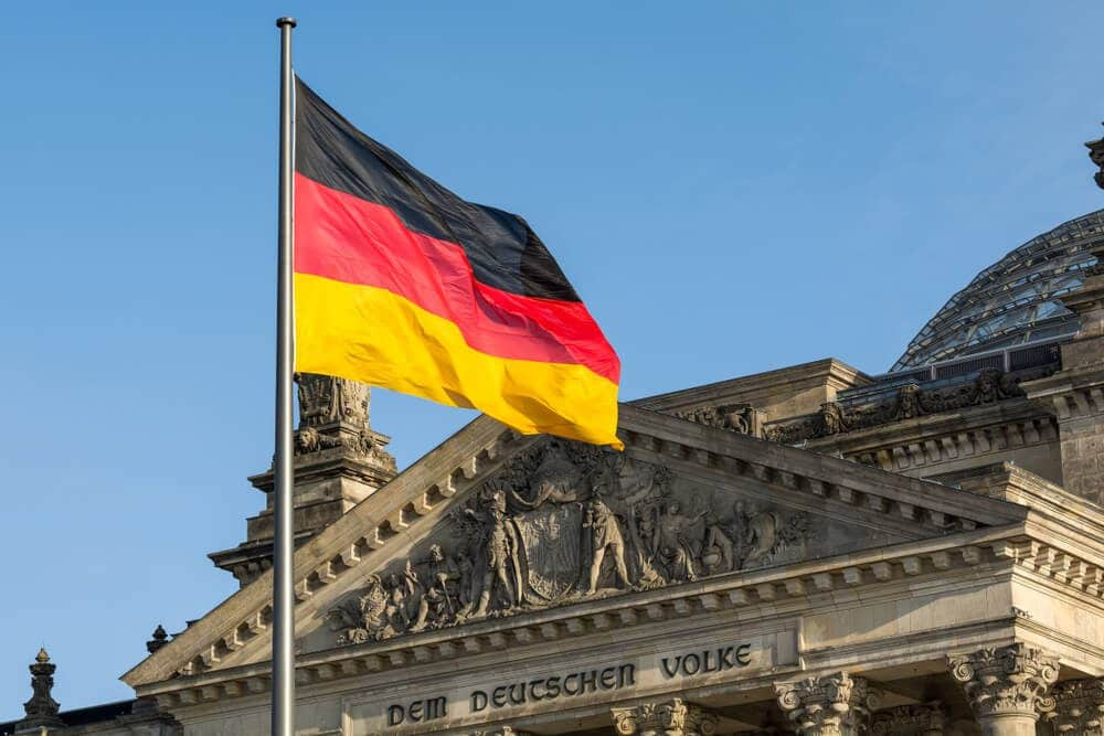 Facade of the German Parliament with the German flag fluttering