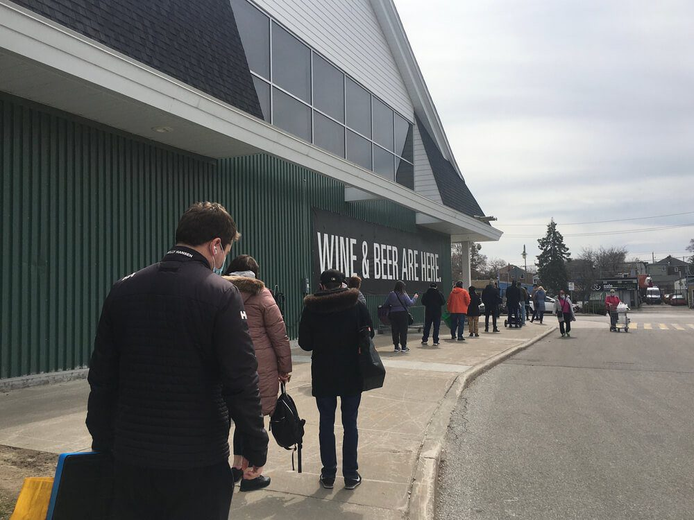 People line up outside Loblaws grocery store during Ontario 3rd wave lockdown in Toronto Canada