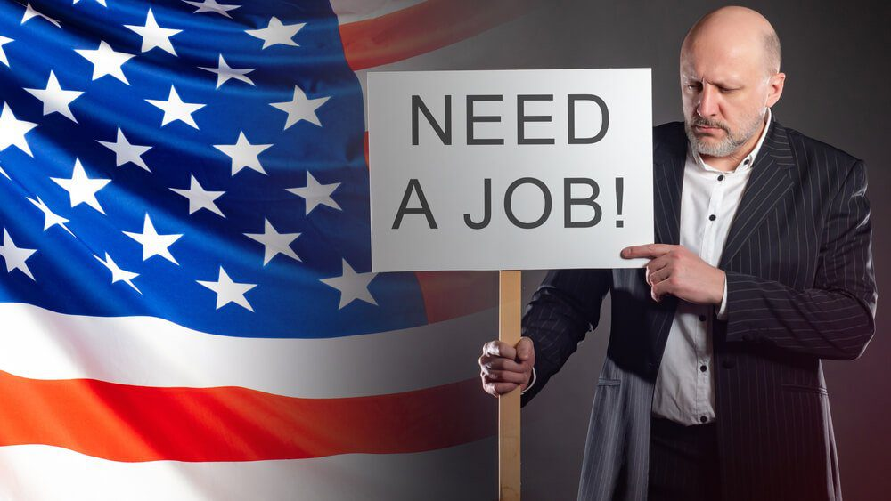 US Unemployment Sad man with a poster about job search