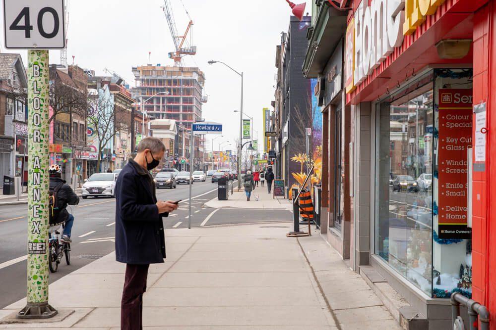 Canada lockdown people wearing masks on near empty streets toronto ontario canada