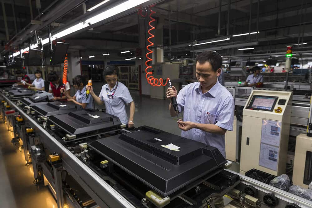 China also reported Caixin manufacturing index PMI Workers assemble TV in TCL television assembly factory.