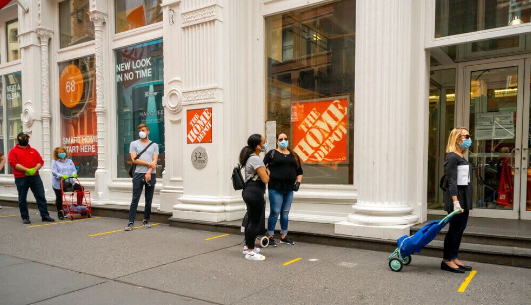 US Consume confidence People practice social distancing protocols as they wait to enter a Home Depot store in Chelsea