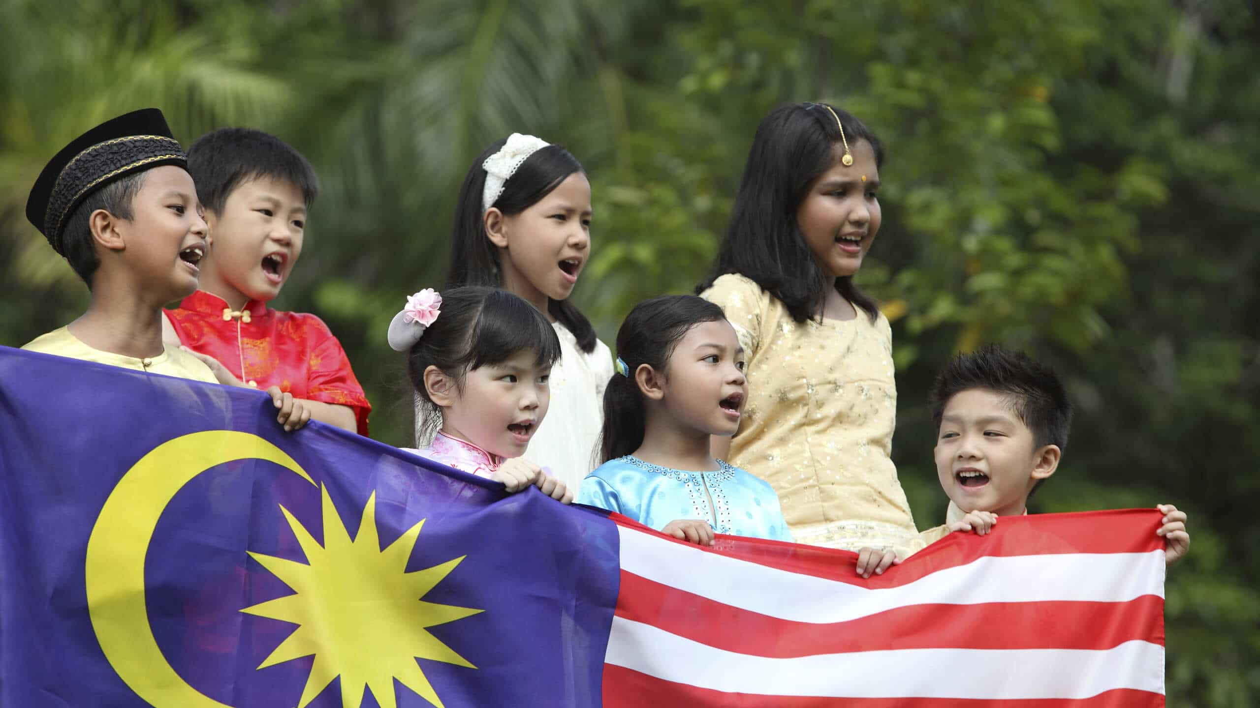 malaysia children with malaysian flag in hand