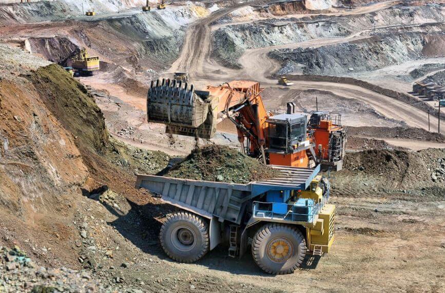 Australia Loading of iron ore on very big dump body truck