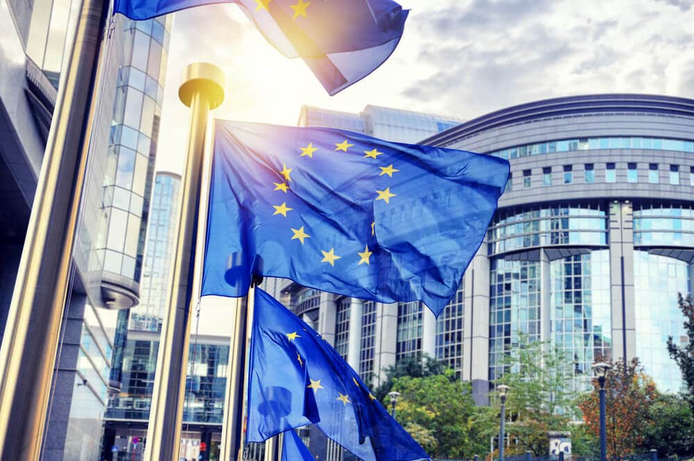 EU flags waving in front of European Parliament building. Brussels Belgium