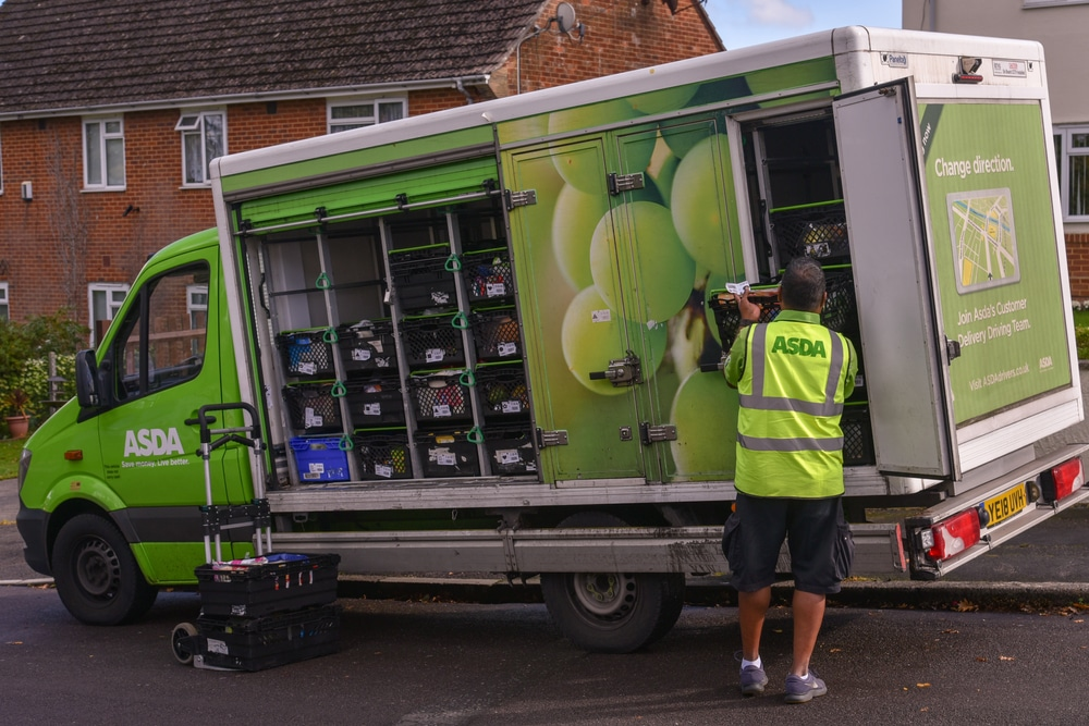 UK Bournemouth A driver of ASDA retailer gets groceries ready for delivery