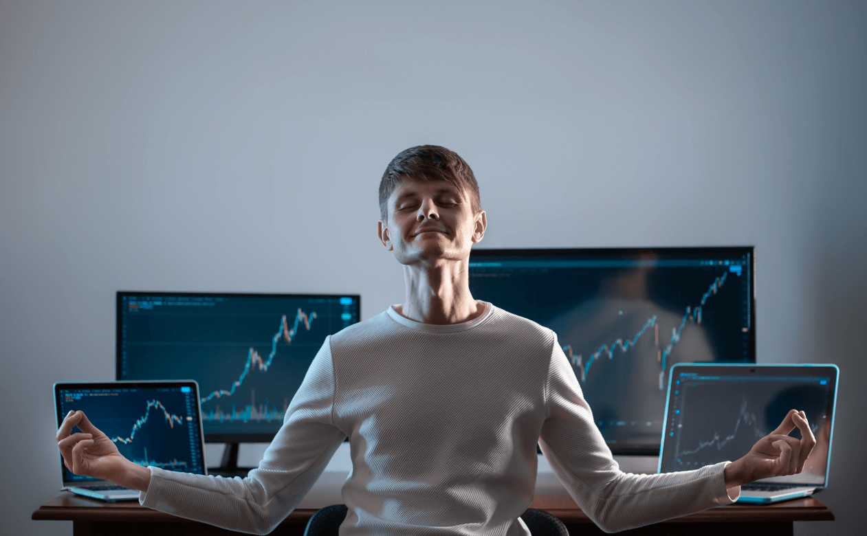 Relaxed successful trader in forex market sitting in front of his monitor charts 1